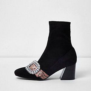 Black snakeskin buckle block heel sock boots