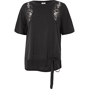 Donkergrijs T-shirt met bloemenapplicatie en strikjes aan de zoom