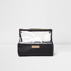 Zwarte reistoilettas met doorzichtig plastic