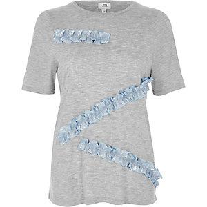 T-shirt gris métallisé asymétrique à volant