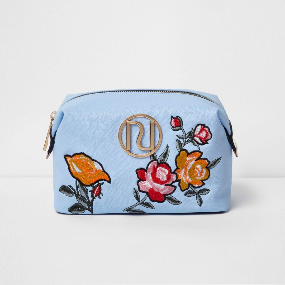 Blue floral embroidered make-up bag