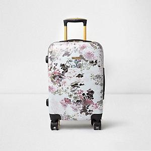 Roze plastic koffer met vier wieltjes en bloemenprint