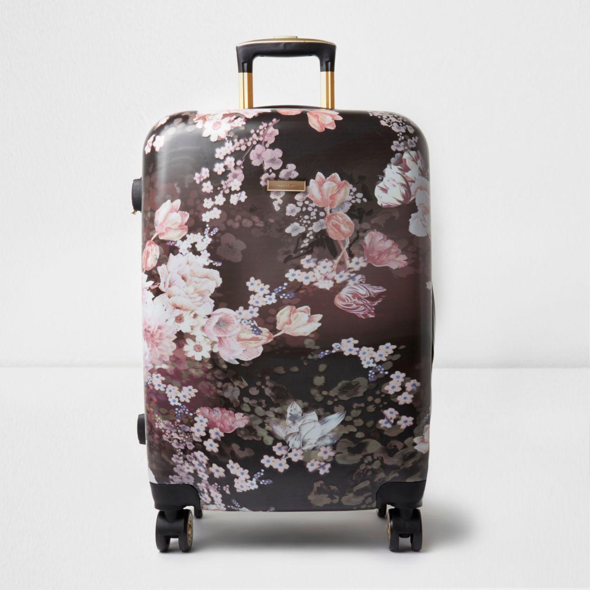 Valise rigide noire à fleurs