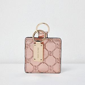 Miroir avec logo RI en relief or rose