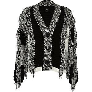Cardigan colour block noir et blanc à franges