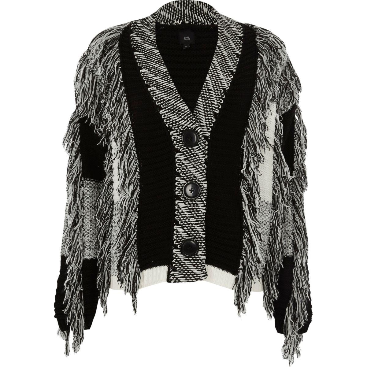 Zwart-wit vest met kleurvlakken en franjes