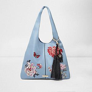 Blauwe oversized tas met geborduurde bloemen