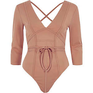 Light pink plunge boning bodysuit