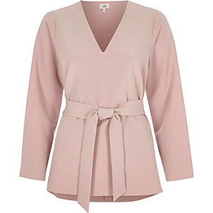 Light pink long split sleeve tie waist top