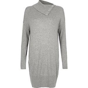 Grijze trui-jurk met geribbelde mouwen drukknopen bij de hals