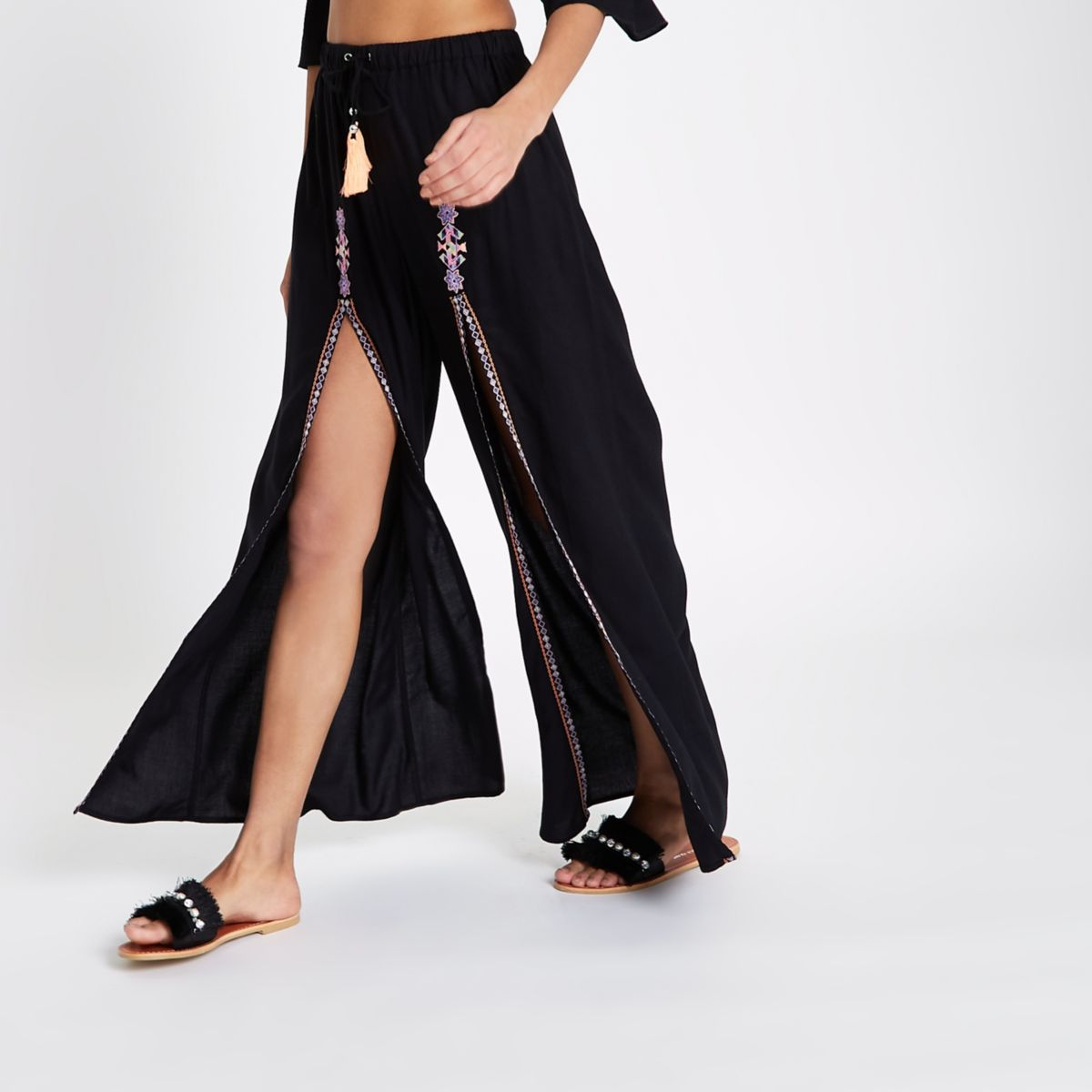Black split embroidered palazzo trousers