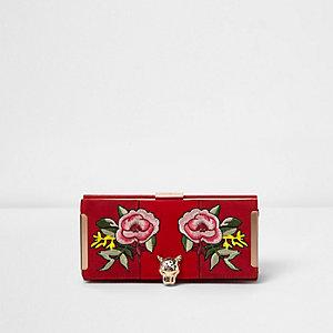 Portefeuille à rabat rouge motif tête de léopard à rose appliquée