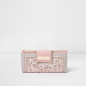 Roze smalle glitterportemonnee met lipje