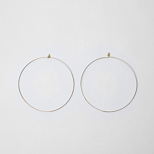 Gold tone oversized hoop earrings