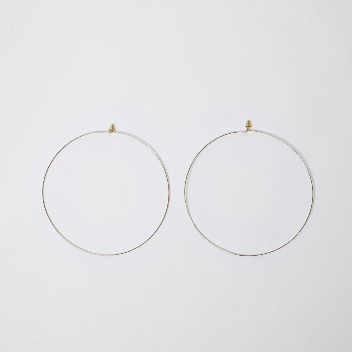 Gold tone oversized hoop earrings