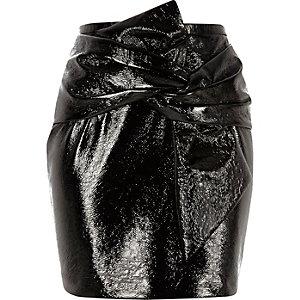 Black vinyl bow front mini skirt