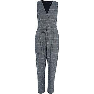 Combinaison à carreaux grise avec ceinture à taille corsetée