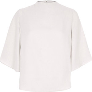 Beige high neck cape sleeve top