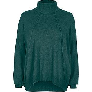 Pull vert à col montant et coutures exposées