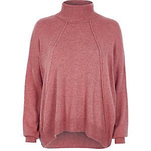 Pink roll neck exposed seam sweater