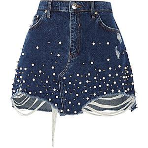 Mini-jupe en jean bleue ornée de fausses perles