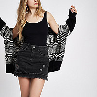 Black distressed denim mini skirt