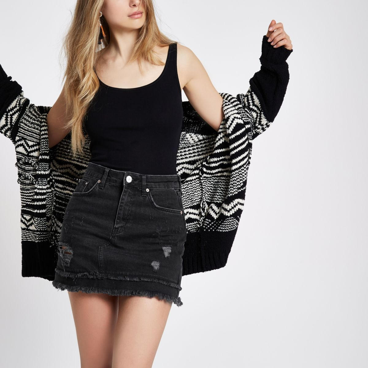 Mini-jupe en jean noir usé