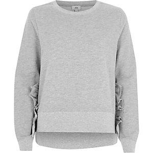 Grijze sweater met ruches
