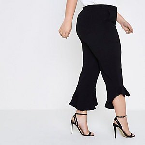 Plus black frill hem cropped trousers