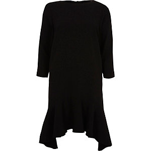 Black peplum hem long sleeve swing dress