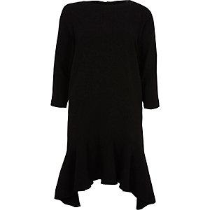 Robe évasée noire à manches longues et ourlet péplum