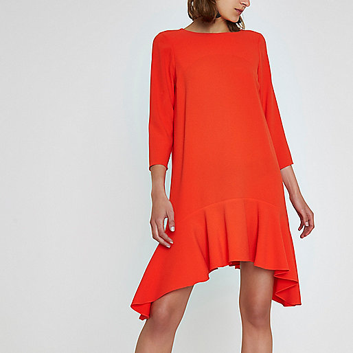 Red peplum hem long sleeve swing dress