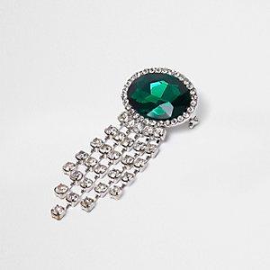 Zilverkleurige broche met ketting en ingelegde smaragd