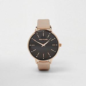 Horloge met zwarte ronde wijzerplaat en beige bandje
