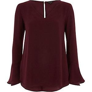 Burgundy long bell sleeve frill back top