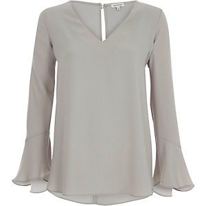 Grey long bell sleeve frill back top