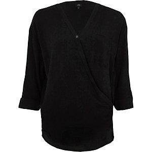 Zwarte ruimvallende blouse met overslag voor