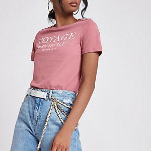 Roze aansluitend T-shirt met 'Voyage'-print