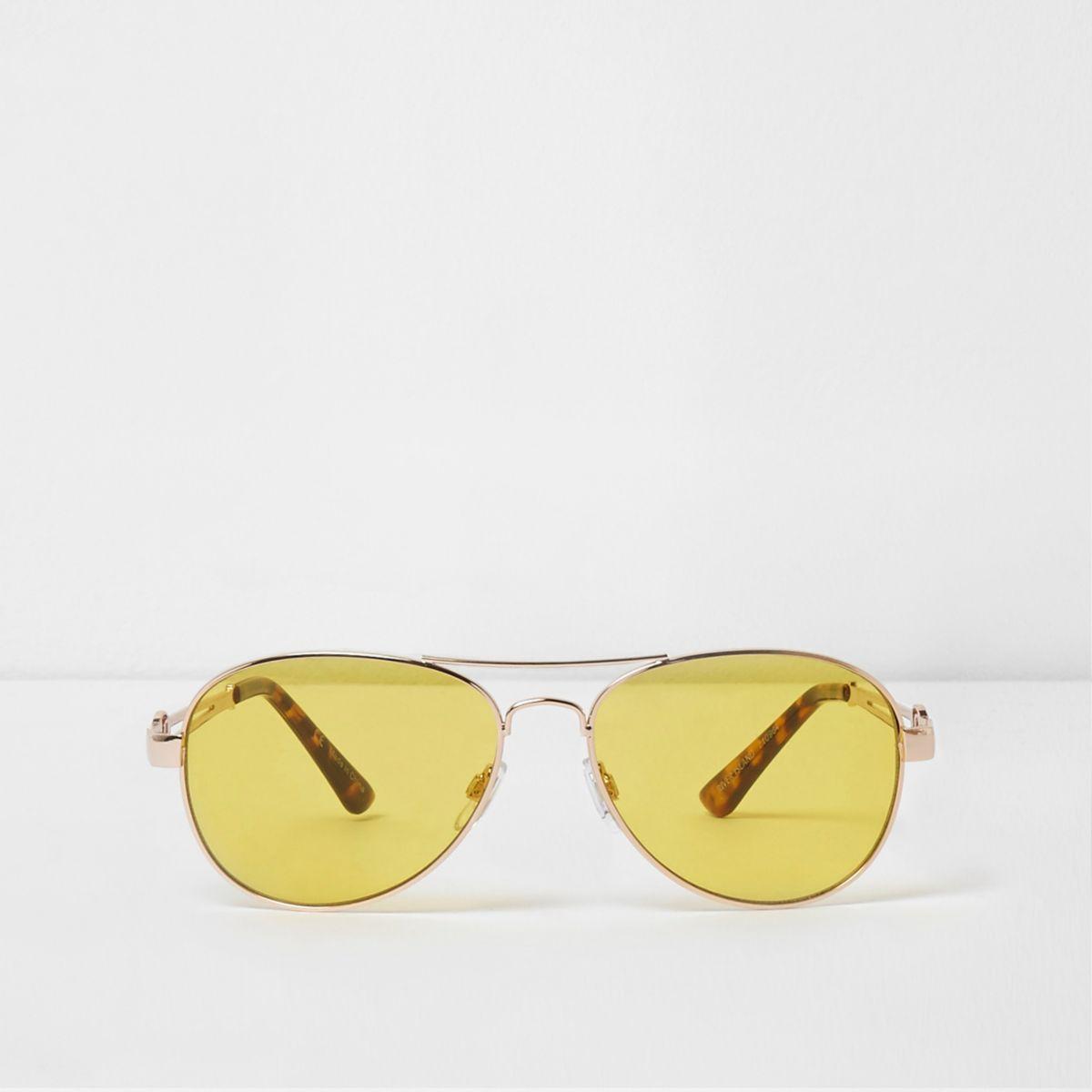 Goudkleurige pilotenzonnebril met gele glazen