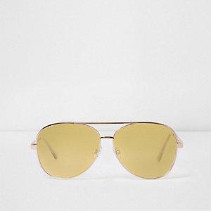Goudkleurige pilotenzonnebril met doorzichtige lila glazen