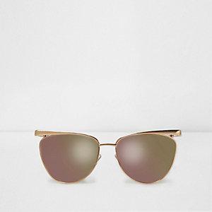 Goudkleurige cat-eye-zonnebril met roze spiegelglazen