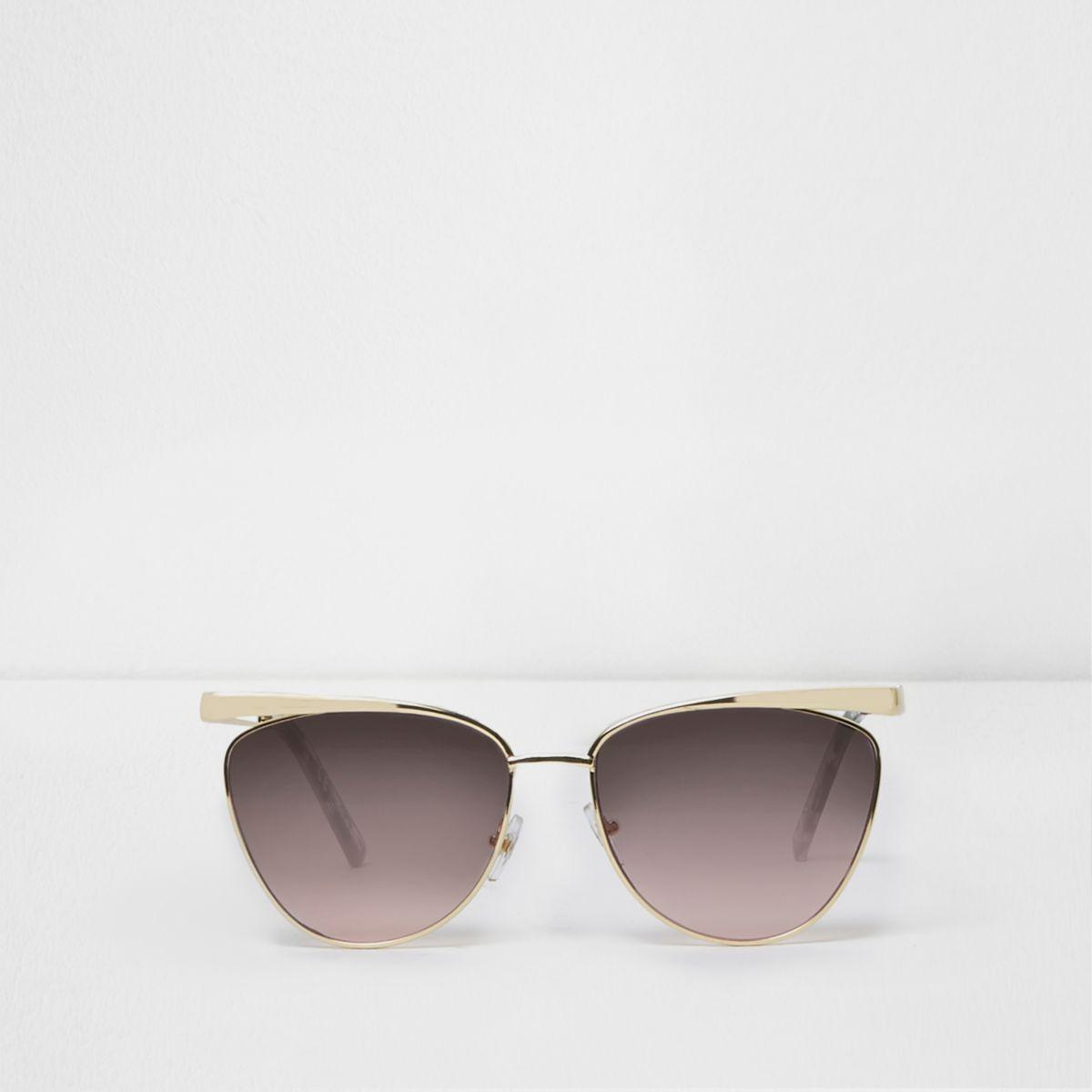 Gold tone cat eye ocean lens sunglasses