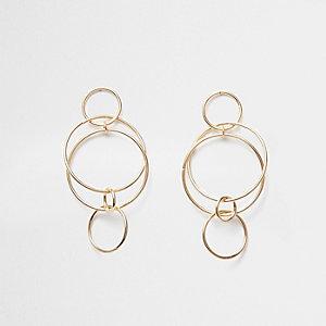 Pendants d'oreilles à anneau dorés