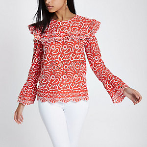 Red broderie frill bib top