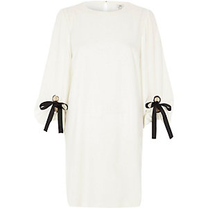 White balloon tie sleeve swing dress