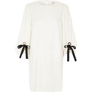White balloon tie sleeve swing dress