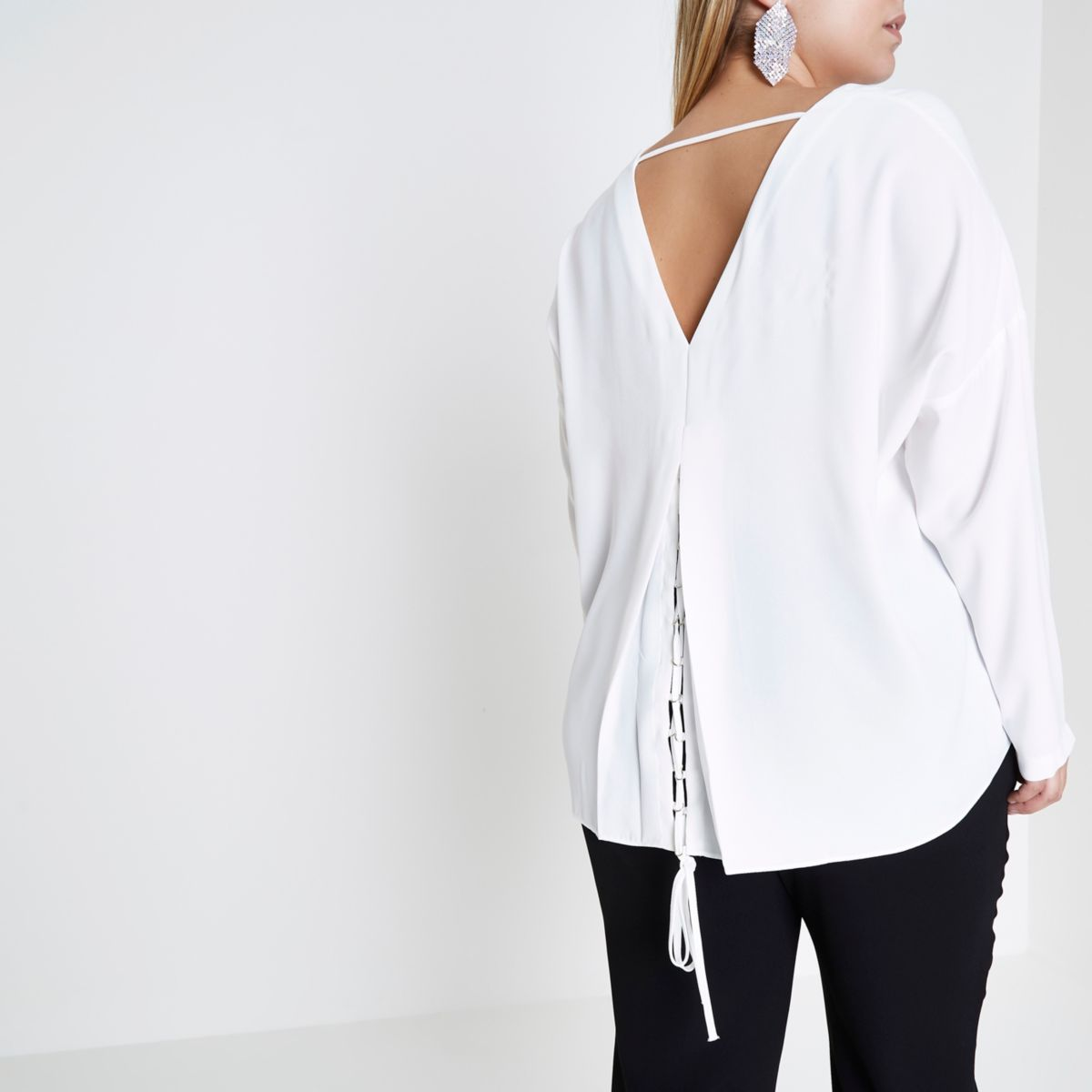 Plus cream lace-up back long sleeve top