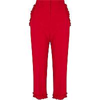 Rode cropped broek met ruches aan de zoom