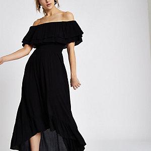 Robe Bardot longue et asymétrique noire à volants