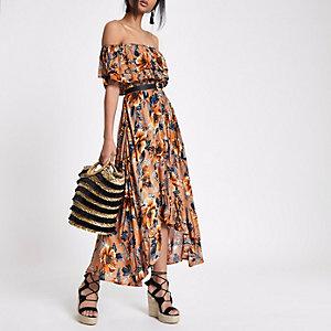 Bruine maxi-jurk met bloemenprint en ongelijke zoom